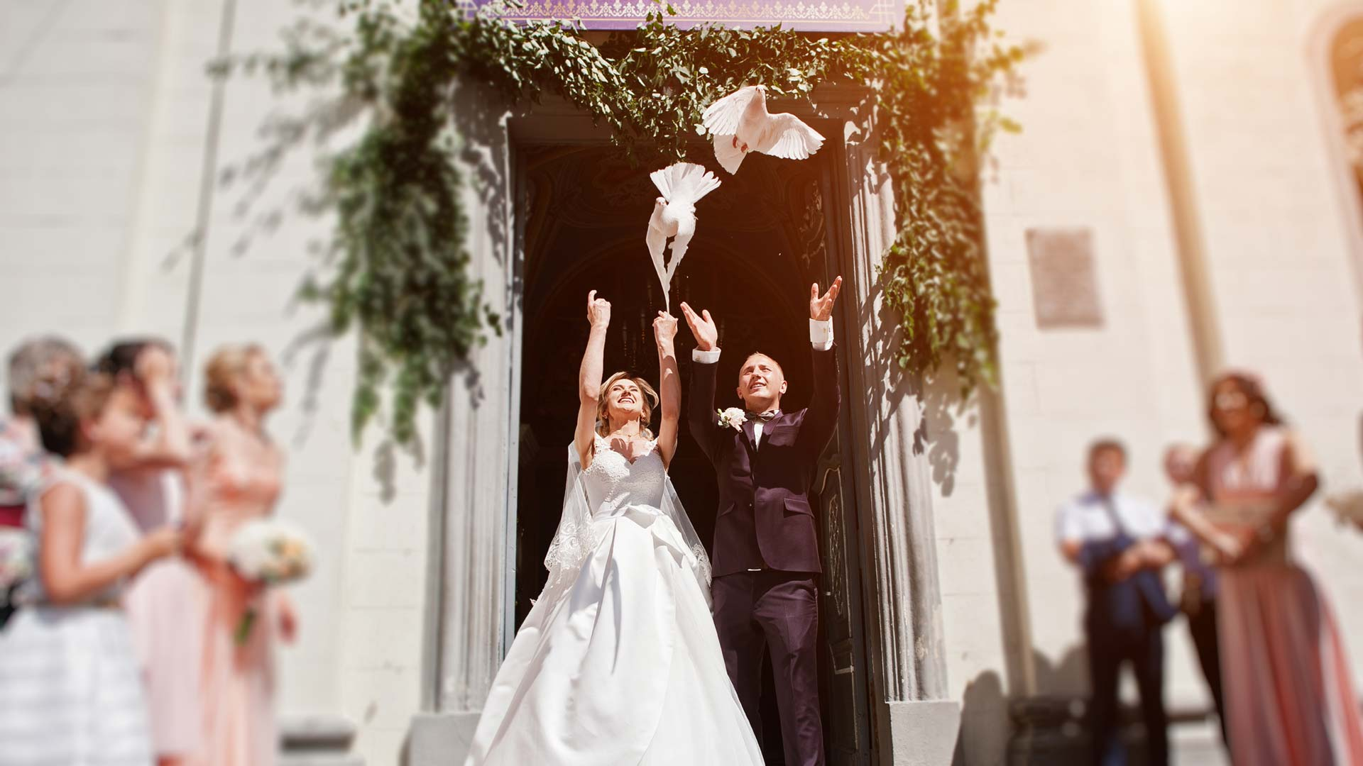 Two beautiful white doves being released by the bride and groom at a wedding ceremony in Baltimore, MD.
